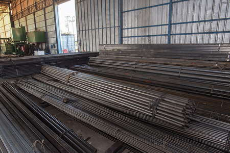 Steel rods IN shape.Stock warehouse many kind of iron tube, carbon steel,pipes round iron.Stock types of steel are new to work construction and building systems.