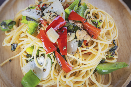 Spaghetti. Tomato sauce and vegetables.Tasty Appetizing classic Italian spaghetti pasta with tomato sauce and vegetable.
