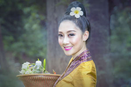Beautiful Laos Women wearing Laos traditional dress costume,Asian girl wearing traditional Laos culture,vintage style,traditional of Laos suit. Stockfoto