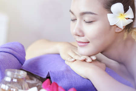 Young woman enjoying massage in spa salon,people relaxed in the nature massage,body care,Spa body treatment, people having massage in the nature. Stockfoto