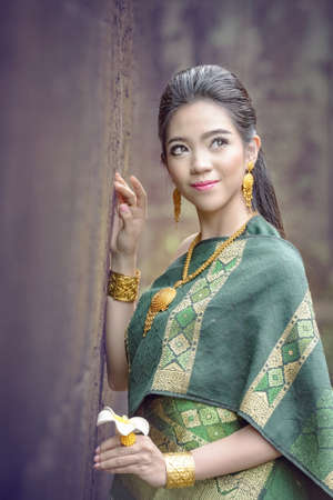 Beautiful Laos Women wearing Laos traditional dress costume,Asian girl wearing traditional Laos culture,vintage style,traditional of Laos suit. Stok Fotoğraf