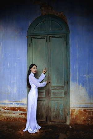 Beautiful woman with  Ao dai vintage style. Beautiful girl with Vietnam culture traditional dress, Life of Vietnamese. Ao dai is a traditional costume famous Ho Chi Minh Vietnam.Hoi an Vietnam.