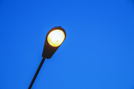 Illumination in outdoor parks with blue background.Modern street lamp against the blue sky.