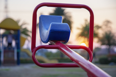Seesaw on a Colorful  children playground for kids.Colorful playground on yard in the park with sunset. Stockfoto
