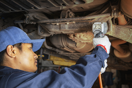 Hands of car mechanic with wrench in garage.Auto mechanic working in auto repair service.Repair service.Car repair and maintenance. Stockfoto