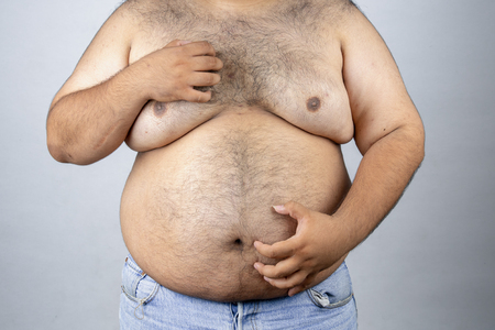 Fat men on a white background. Fat man with a big belly. Fat man eat a lot of food, extra weight, diet. Stockfoto
