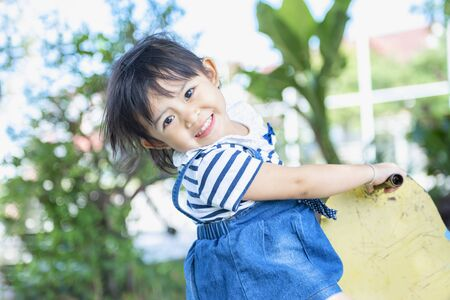 Cute little Asian girl is enjoying the player on the playground. Little girl playing at the playground. 版權商用圖片