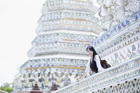 Beautiful Lao girl tourists visiting Thai temples,Bangkok,Thailand.