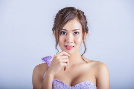 Portrait of a beautiful asian woman smiling brightly at the camera. Natural female beauty concept.