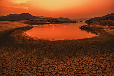 Dry riverbed, Low water level in the dried-out riverbed of the river with sunset background. Stok Fotoğraf