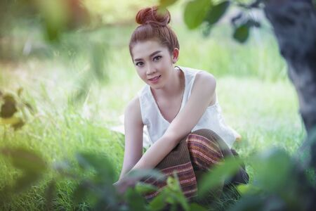 Beautiful Asian women relaxing with fresh nature.