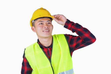 Portrait of young handsome engineer with safety helmet reflective vest. Stock fotó