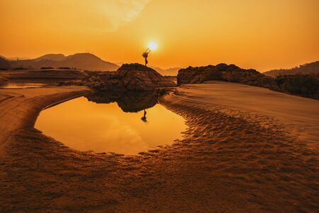 Dry riverbed, Low water level in the dried-out riverbed of the river with sunset background. Stock fotó