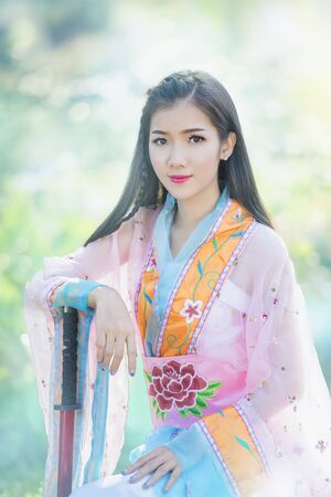 Beautiful Asian women wearing traditional Chinese clothing. Stock fotó