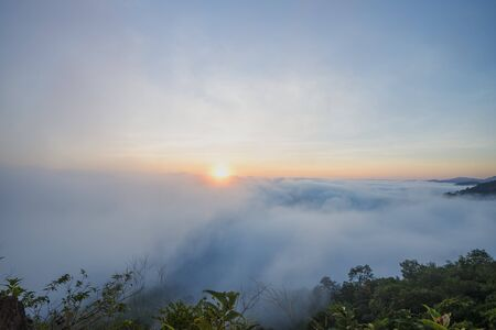 View of fog on the top of the hill. Fresh air with beautiful sunrise and mist. Stok Fotoğraf