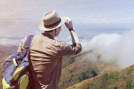 Hipster young Traveler with backpacks enjoying sunset at the mountain. Landscapes of Vang Vieng, Phoupeangfa view point at Phou Khoun, Vang Vieng , Laos.
