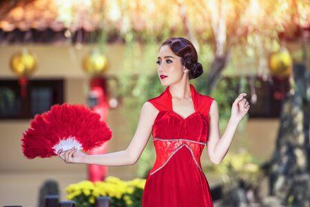 Chinese dress,Asian woman in chinese dress traditional cheongsam. Beauty woman wear Cheongsam  in chinese new year.