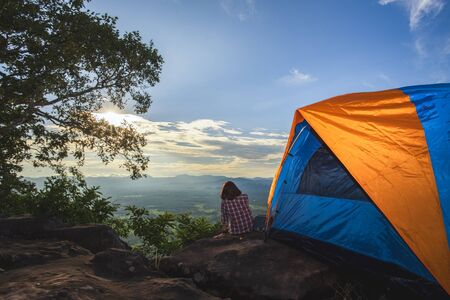 Tourists pitch a tent on the cliff to see the beauty of the sunrise and sunset.