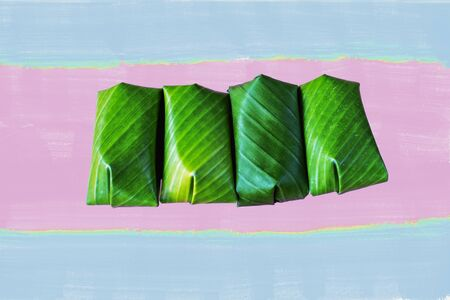 Porridge is made from rice wrapped in banana leaves to be eaten as Thai food.