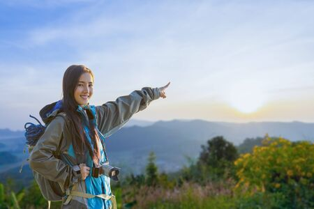 Travelers and traveling to nature. Hipster young travelers with backpack enjoying nature of mountain. Adventurer hiker looking beautiful nature.