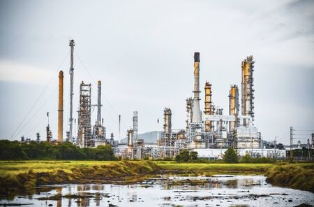 Oil refinery plant from industry zone, Oil and gas petrochemical industrial, Refinery factory oil storage tank and pipeline steel. Stock Photo