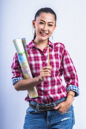 Beautiful young working women grinning professional in office confident expression. A confident young woman is checking the job. Have the opportunity to work everywhere. Stock Photo