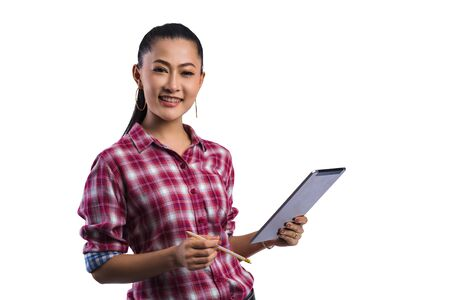 Beautiful young working women grinning professional in office confident expression.A confident young woman is checking the job with laptop.Have the opportunity to work everywhere.image with saved path