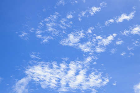 Soft white clouds against blue sky. Blue sky with beautiful natural white clouds.