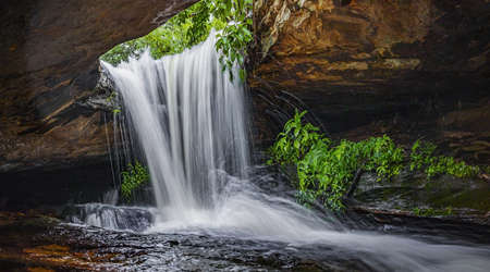 Panoramic photo landscape, Waterfall hidden in the tropical, The beautiful waterfall in forest, The fascinating waterfall in the forest and water flows through a hole.