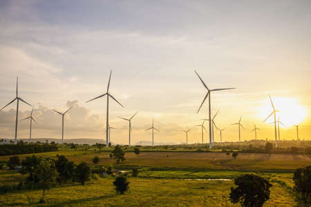 Wind turbines, Eco power and agricultural fields with sunset landscapes , Energy Production with clean and Renewable Energy. Protection of nature. Stok Fotoğraf