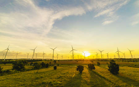 Wind turbines, Eco power and agricultural fields with cloudy day sunset landscapes on the mountain, Energy Production with clean and Renewable Energy. Protection of nature. Stok Fotoğraf