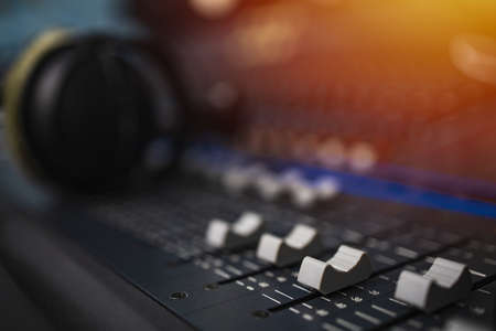 Recording room,Compression room, Music on sound mixer in recording studio.Close Up Shot of Audio Producer Working in Music Recording Studio, Uses Mixing Board Create Modern Song. Sound recording room. Stok Fotoğraf
