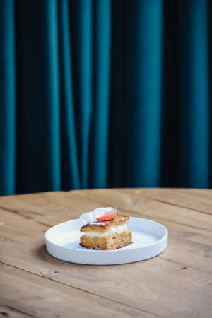 Delicious strawberry cake with whipped cream on wooden table. Mille Feuille of Strawberries.