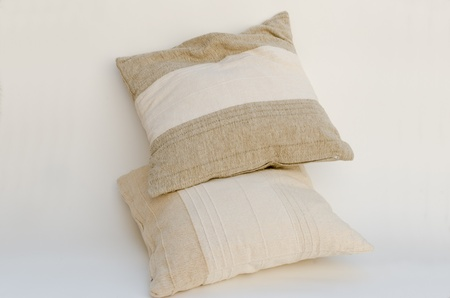 two beige pillows isolated on white photo