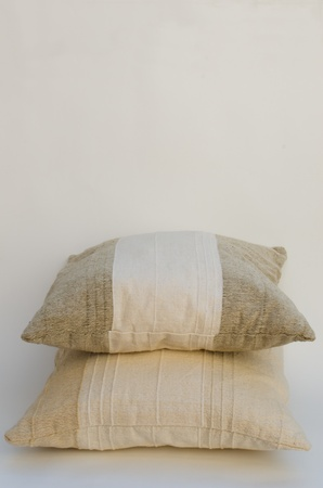 two beige pillows isolated on white Stock Photo - 9978739