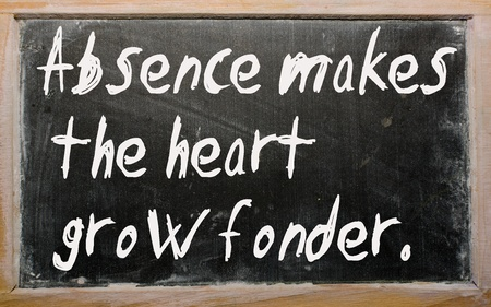 absence: Blackboard writings Absence makes the heart grow fonder Stock Photo