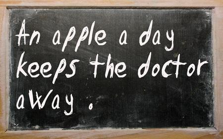 Blackboard writings An apple a day keeps the doctor away photo