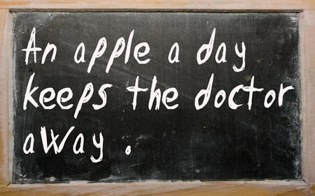 Blackboard writings An apple a day keeps the doctor away photo