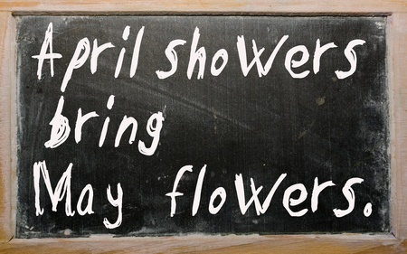 Blackboard writings April showers bring May flowers photo
