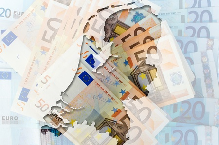 Outlined map of Netherlands with transparent background of euro banknotes photo