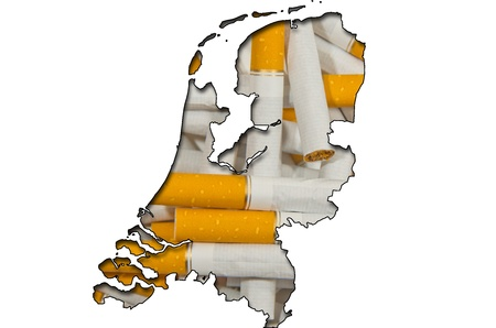 Outlined map of Netherlands with background of cigarettes photo