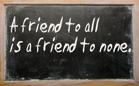 Blackboard writings A friend to all is a friend to none Stock Photo - 10504760