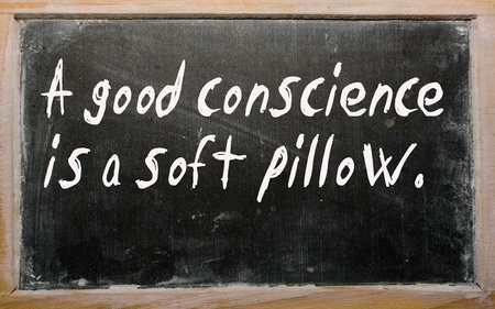 conscience: Blackboard writings A good conscience is a soft pillow Stock Photo