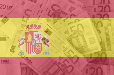 transparent spanish flag with euro banknotes photo
