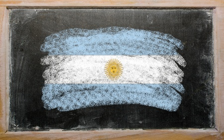 Chalky argentinian flag painted with color chalk on old blackboard photo
