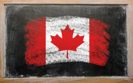 canadian flag: Chalky canadian flag painted with color chalk on old blackboard