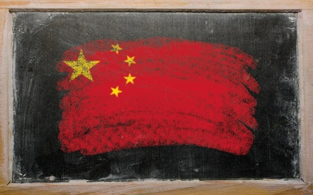 Chalky chinese flag painted with color chalk on old blackboard Stock Photo