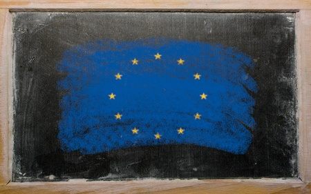 Chalky european union flag painted with color chalk on old blackboard photo