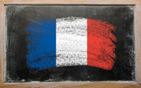 Chalky french flag painted with color chalk on old blackboard