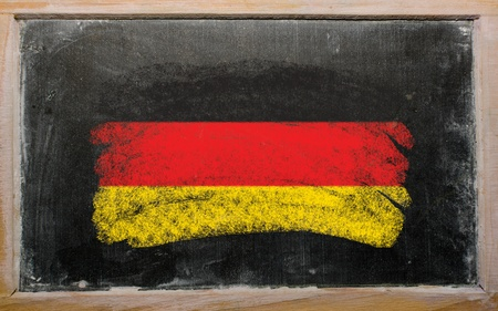 Chalky german flag painted with color chalk on old blackboard photo